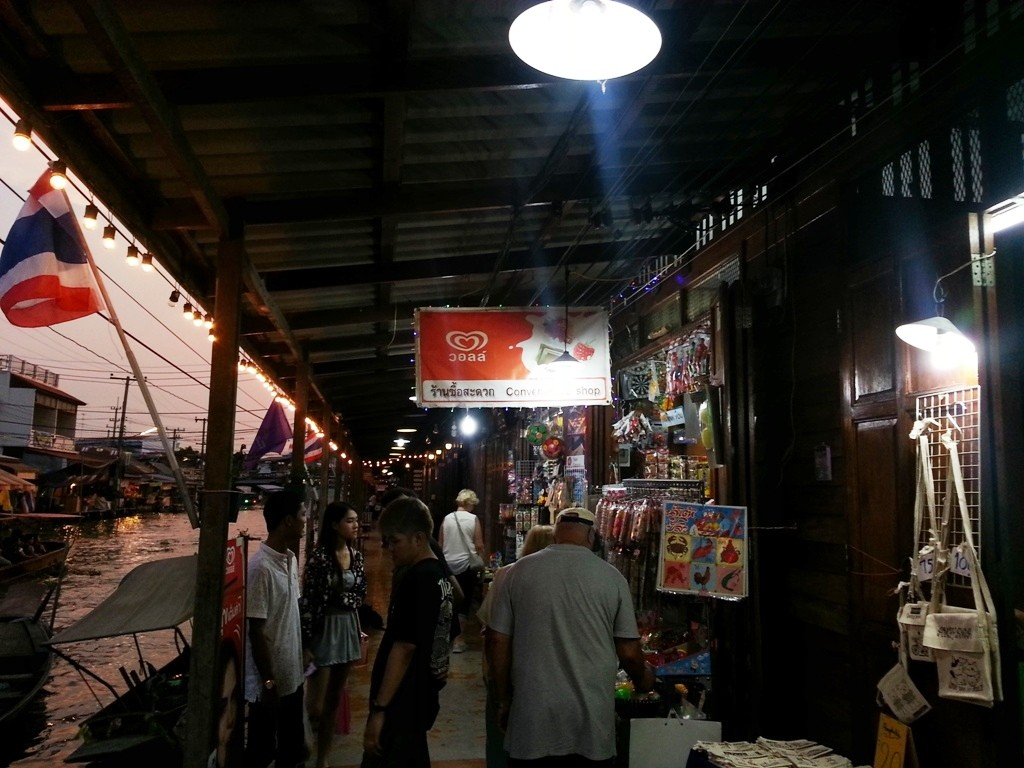 Photo showing our tours guests taking a quiet evening stroll at Amphawa Floating Markets