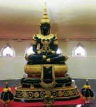 Black and gold statue inside Black Buddha Phetchabura Buddha Park