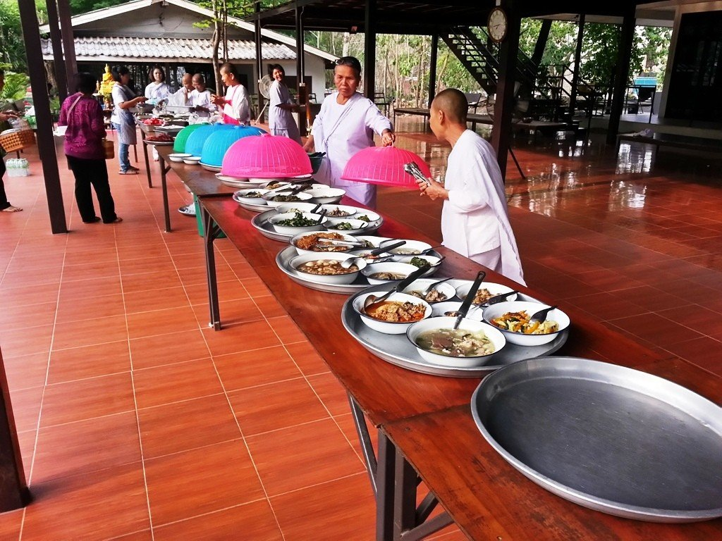 The nuns and ladies from the village prepare the buffet style meal for the monks