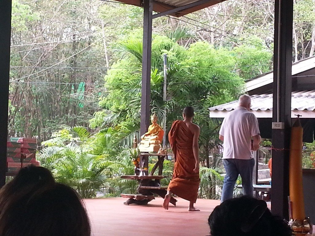 The bowl is being carried to the temple where the monk will eat