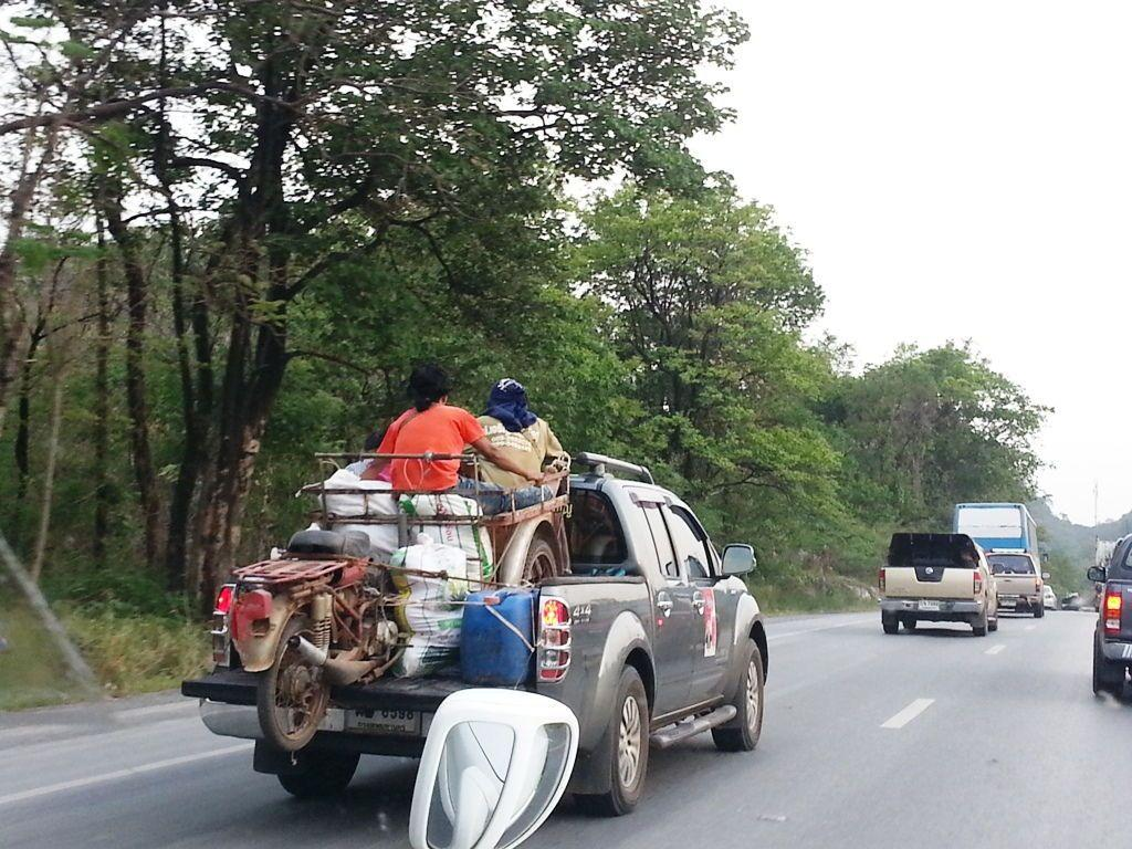 Articulated motorbike in pickup with 3 people in sidecar