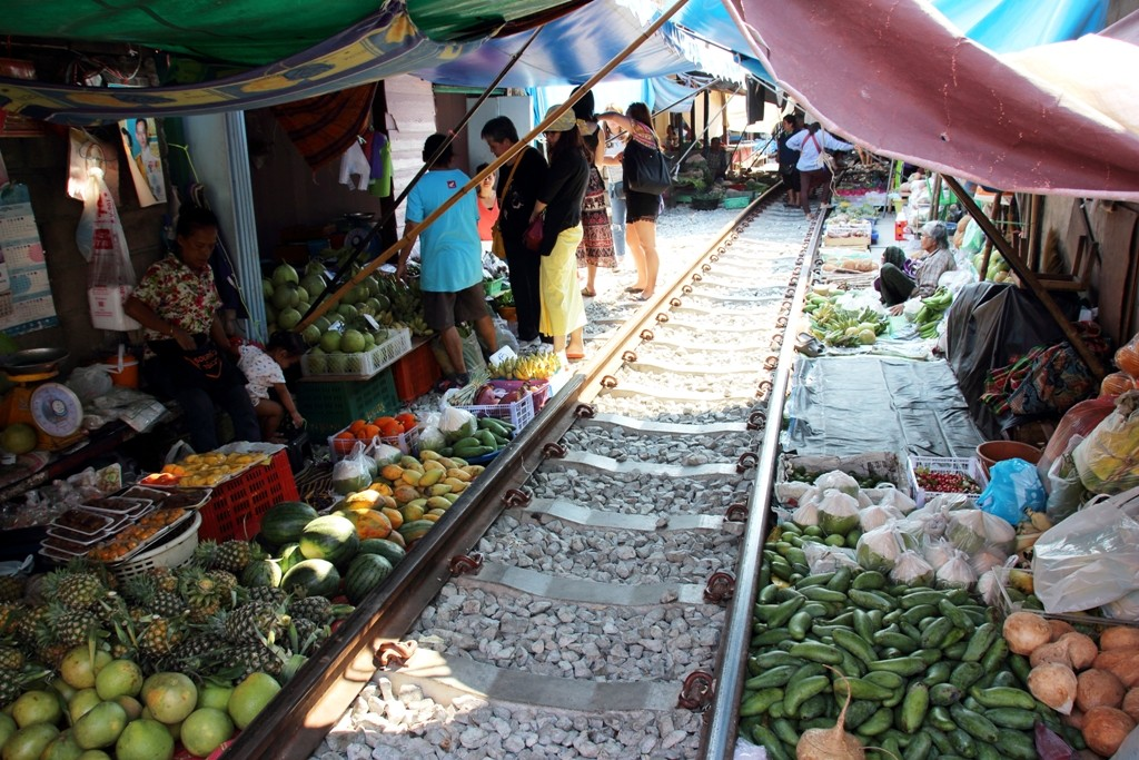 Produce on the ground close to the rails at Maeklong Railway Market