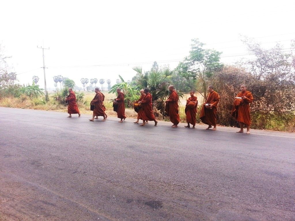 Ten Thai Buddhist Monks crossing the road for Pindapata