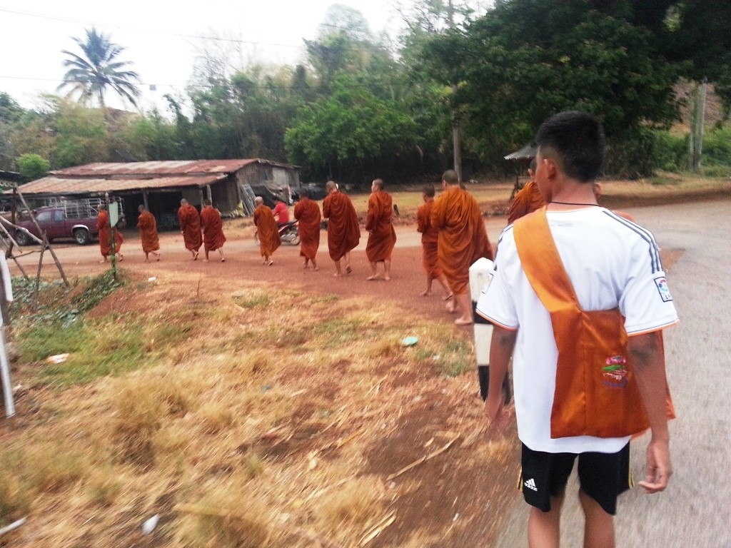 Buddhist Monks enter the village.