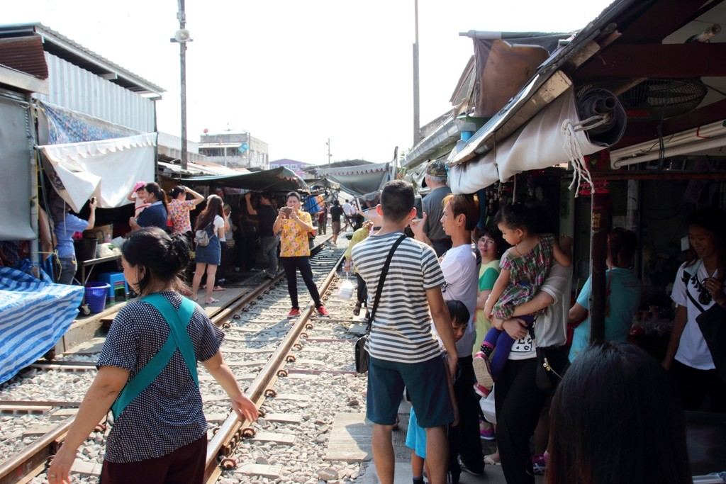 Waiting for train at Maeklong Railway Market