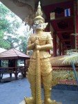 Golden Yak standing guard outside the old Wat Tub Berk Phetchabun Northern Thailand